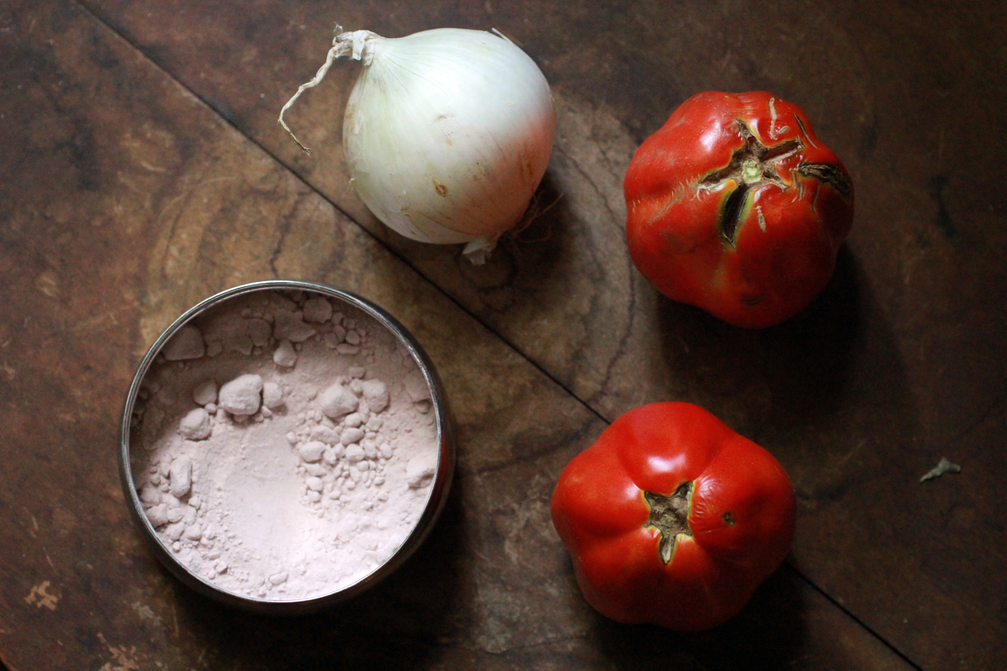 tomatoes, onion and rock salt