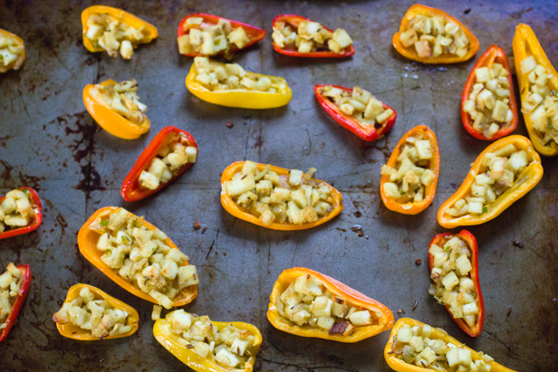 stuffed mini peppers on baking sheet