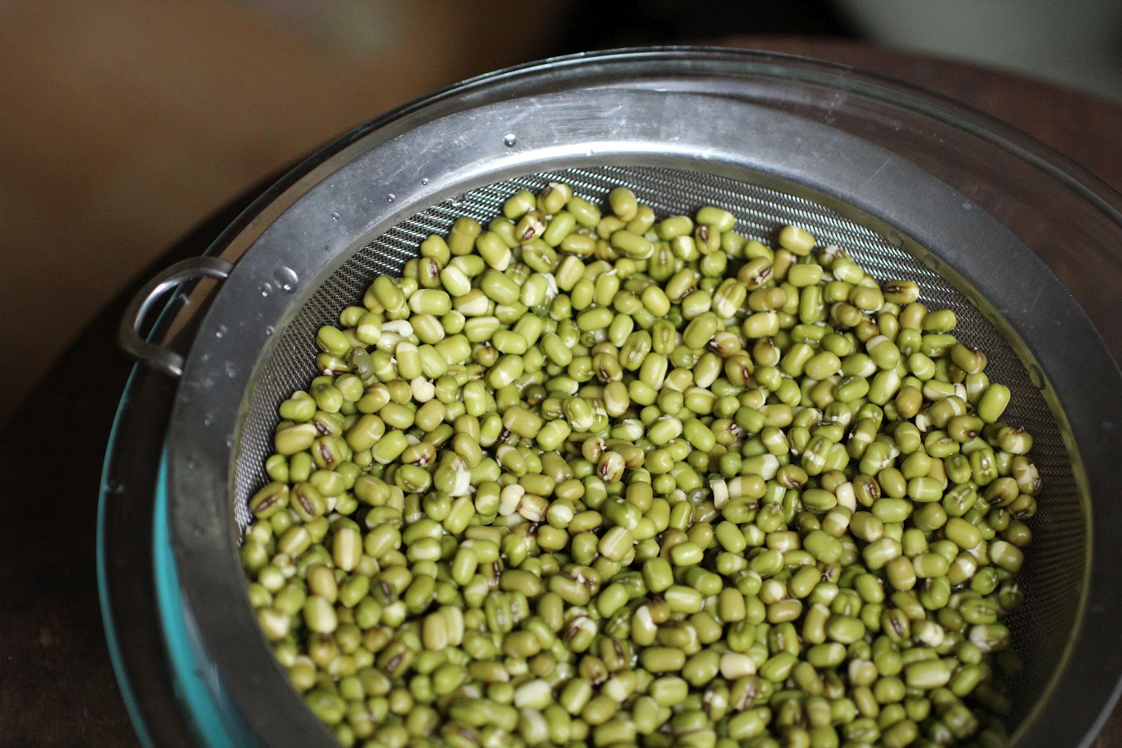 drained moong dal or mung bean in colander